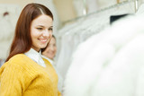 women choosing white bride dress