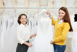 Two women choosing white dress