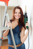 Sexy woman in dungarees with drill
