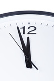 Close-up of clock face. Two minutes to midnight concept