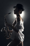beautiful girl saxophone in hand
