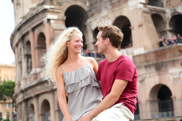 Travel couple in Rome by Coliseum in love