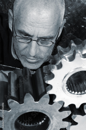 engineer studying the geometry of gears and cogwheels