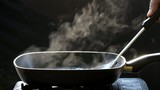 steam on pan in kitchen