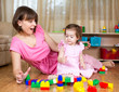 mom and child play with toys at home