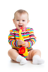 baby playing musical toy