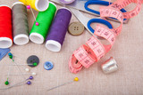 Tools for needlework, thread, scissors, pins, measure type and
