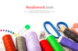 Sewing tools, thread, scissors, pins and measure type on white