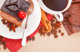 Cup of coffee with spices and chocolate cake with cherry