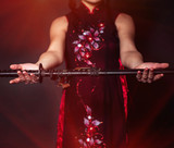 Woman with japan sword katana in hands