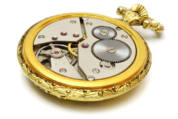 closeup of old vintage pocket gold watch isolated