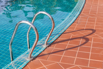 Swimming pool with stainless steel ladder