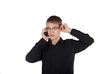 teenager thoughtfully talking on the phone