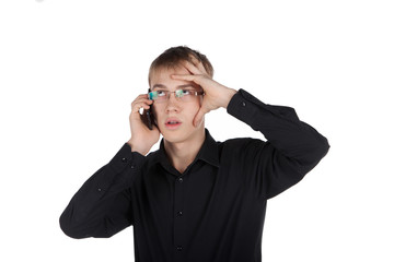 teenager in glasses thoughtfully talking on the phone