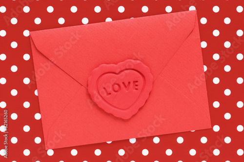 Love letter in a red envelope sealed with a heart