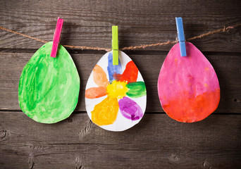 child's drawing of Easter eggs on wooden background