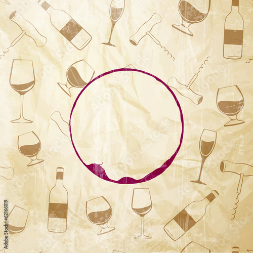 Red wine drops over text paper background.