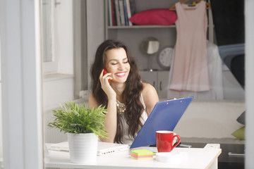 Beautiful young businesswoman using her smartphone