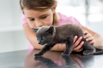 Girl playing with kitten
