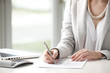 Close-up of businesswoman fill the form.