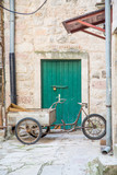 Three Wheeled Bike with Cart by Green Door