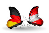 Two butterflies with flags Germany and Austria