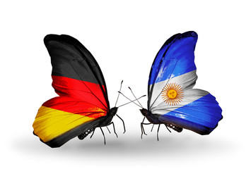 Two butterflies with flags Germany and Argentina