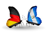 Two butterflies with flags Germany and Guatemala