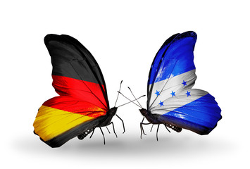 Two butterflies with flags Germany and Honduras