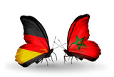 Two butterflies with flags Germany and Morocco