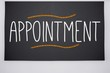 Appointment written on big blackboard