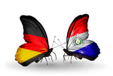 Two butterflies with flags Germany and Paraguay