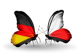 Two butterflies with flags Germany and Poland
