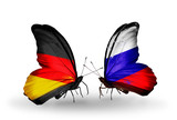 Two butterflies with flags Germany and Russia