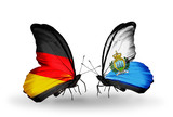Two butterflies with flags Germany and San Marino