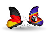 Two butterflies with flags Germany and Swaziland