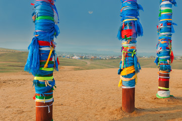 Buryat pillars and village in the distance