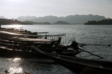 Long tail boats on a lake . Chiew Lan Lake (Rajjaphapa Dam), Tha