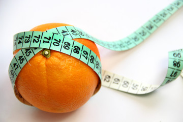 Fruit and measurement tape on the white background