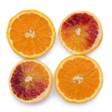 Four pieces of blood oranges and oranges on white