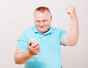 Senior man with phone and hand up
