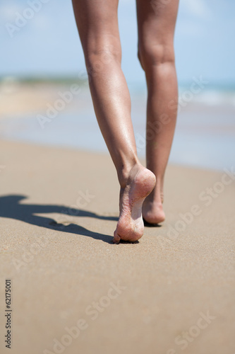 woman legs at sand