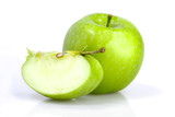 Green apple with a slice on white background