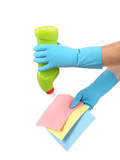 Cleaning with bottle and sponge in hands.