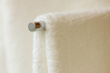 A heated towel rail in a modern apartment block