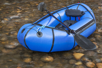 packraft with a paddle