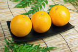 Three Orange on wooden tray