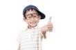 Joyful little boy holding his thumb up