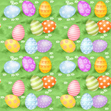 Multi-colored Easter eggs hidden in green grass big seamless bac