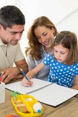 Parents assisting daughter in coloring